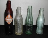 Vintage Collectible bottles four seperate bottles