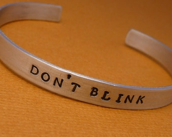 Don't Blink - A Hand Stamped Bracelet in Aluminum or Sterling Silver