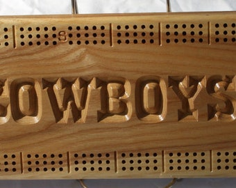 Dallas Cowboys cribbage board made from White Ash wood.