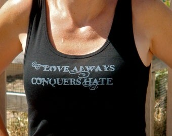 Love Always Conquers Hate done in vintage looking silk screen on a black workout tank top with lace up back