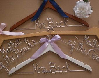 16% off Set of 4 Personalized Custom Wedding hangers & bridal party / wedding party or for someone special.