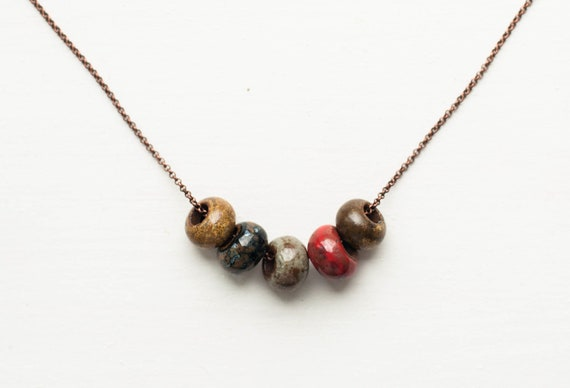 Necklace with porcelain brown, blue and red big beads - porcelain pendant