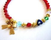 Czeck Crystal Red Beads Bracelet with Gold heart within evil eye and Gold bow with white blue green beads