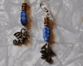 blue and brown dragon earrings