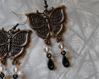 Butterfly and crystal ball earrings