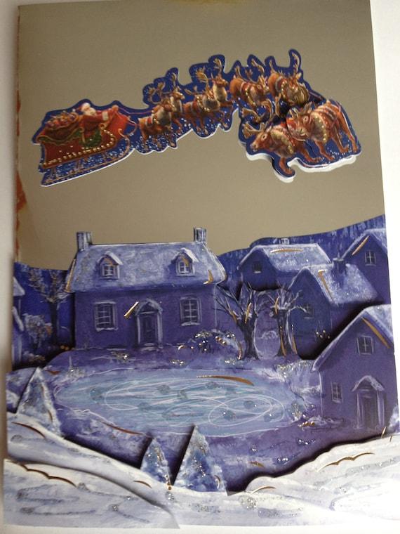 christmas card, village scene, santa and sleigh, snowy scene