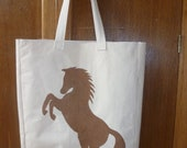 Strong washable canvas tote bag with a rearing bronze horse