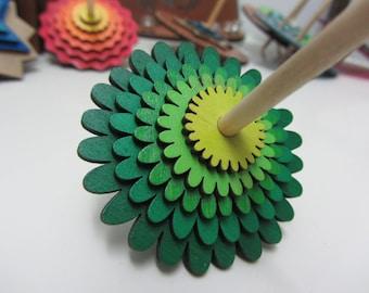 Green flower layered Dreidel (spinning top) for Hanukkah
