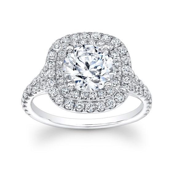 Women\'s platinum engagement ring with 1.50ct Round Brilliant White Sapphire  0.80 ctw diamonds