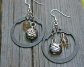 Reclaimed, found objects dangle earrings.