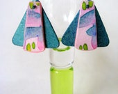 Teal colored earrings with pink abstact print on front portion