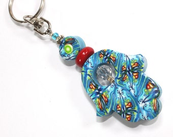 Polymer clay Hamsa keychain, handmade elegant Hamsa keychain in blue, white, turquoise, green together with small red and yellow dots