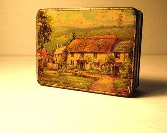 1930 cottage tin....LORNA DOONES tin antique vintage cottage ware home decore storage house thatched roof red door