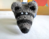 Striped bear with gray-blue knit scarf