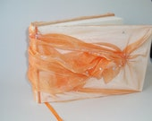 Orange organza wedding photo album. 150 pages, 24x16 cm/approx. 9,5x6,5inches