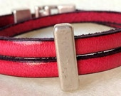 Pink leather wrap bracelet with silver metal bar.