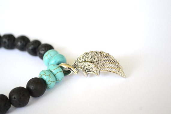 Black Lava Rock and Turquoise Howlite Stretch Bracelet with Angel Wing Charm