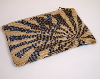 Vintage 1920s unique and rare beaded clutch in a blue black and white starburst design
