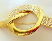Vintage Parklane Brooch Eternity Knot Design in Bright Goldtone with White Rhinestone Melee