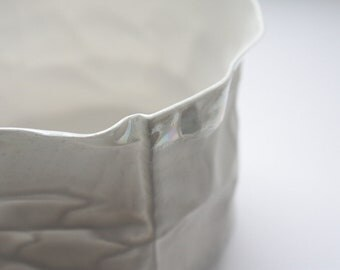 Crumpled paper looking vessel made out of English fine bone china and mother of pearl.