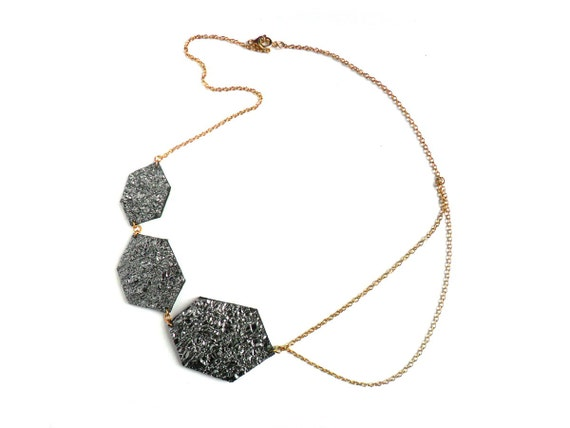 Leather collar necklace with metallic silver diamond shapes and gold plated chain