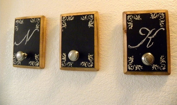 Three chalkboards  with a hooks