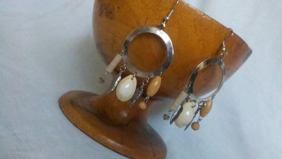 Sea shell, wood, metal feather on a hoop Earring