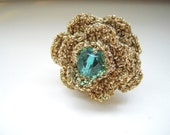 Gold crochet flower ring with a glass bead in the center. Crochet ring.