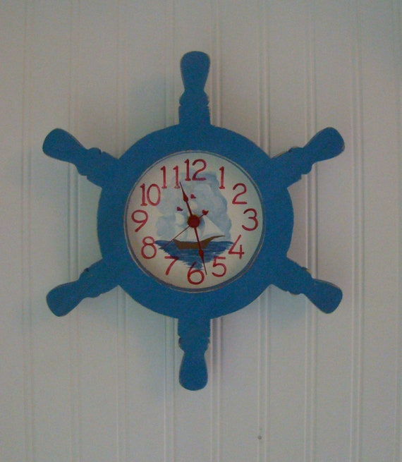 Ship's Wheel Wall Clock with hand-painted schooner face.
