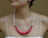 Necklace with bright pink wooden beads