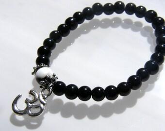 Black Onyx glass bead stretch meditation bracelet - White Howlite bead - OM charm
