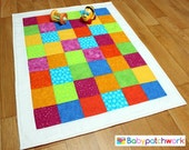 Patchwork baby quilt with gorgeous, bright colours.