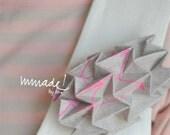 Wearable origami. Hand screen printed: Rosa Laura