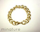 the versailles. gold curb chain bracelet
