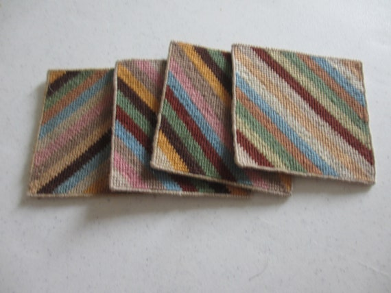 Four needlepoint coasters