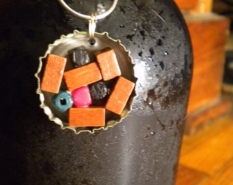 Bottle cap pendant with wooden beads