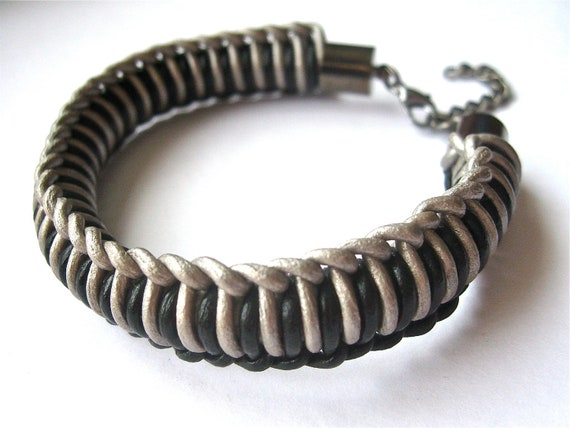woven leather bracelet in black and silver with gunmetal hardware