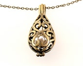 Vintage Bronze-colored Necklace with Faux Pearl held in Filigree Cage