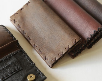 Handmade leather tobacco pouch avaliable in four colors.