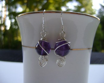Wire wrapped silver ball earrings.