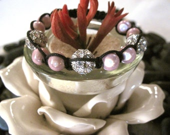 Shambala Bracelet Beautiful soft pink stone with three silver rhinestones.