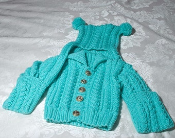 Hand knitted aran jacket with matching hat/scarf attached
