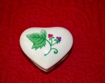 Delicate heart shaped china ring box.