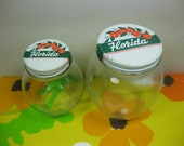 Pair of Vintage Glass Storage Jars with Florida Oranges Lid