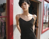 Gorgeous Black with Silver and a little Gold Sparkel Very Sexy Low back size Small.