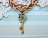 Handmade Leather and Cord Plaited Bracelet with a Bronze Coloured Key Charm, Size Small