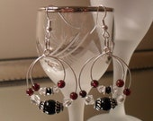 Hoop in hoop garnet and black onyx earrings