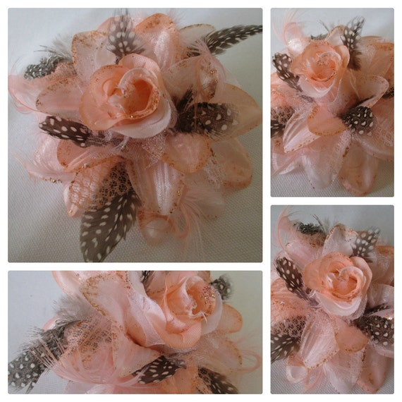 Pinky's Revenge Flower: pink flower accented with primitive designed feathers in a pinup retro design