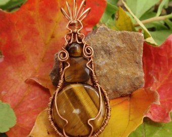 Wire wrapped jewelry handmade Tigers Eye Pendant. Copper wire wrapped