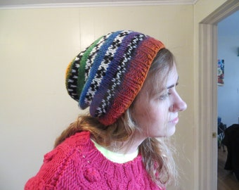 handknit acrylic/wool hat with black and white pattern on verigated background